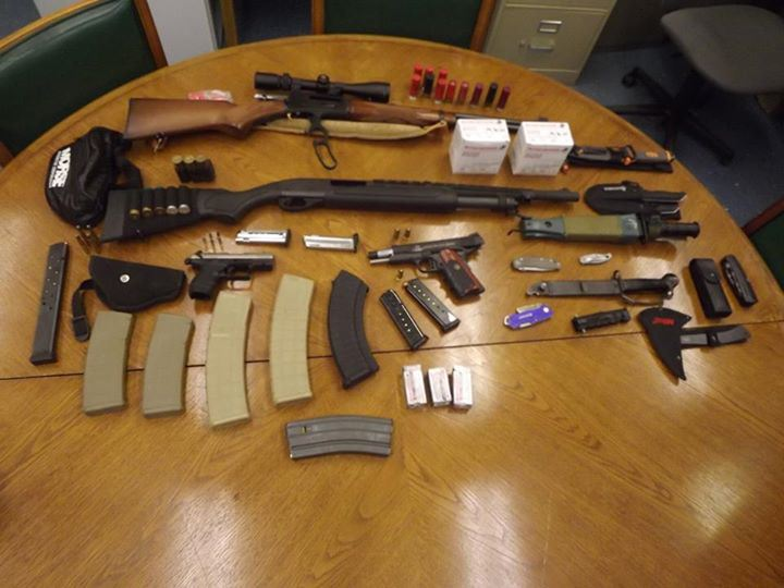Teenager arrested after bringing cache of guns into school