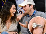 Mila Kunis wears what appears to be a wedding band to basketball game with Ashton Kutcher