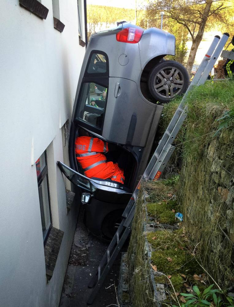 Driver gets stuck between a rock and a hard place