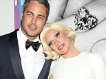 Lady Gaga shows off diamond ring after getting engaged to Taylor Kinney