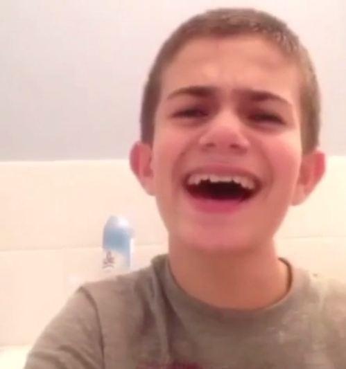 Boy hits puberty halfway through song