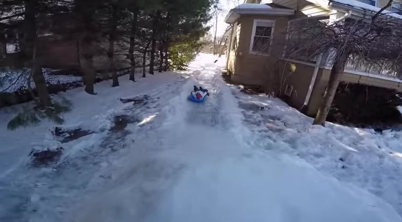 Superdad turns icy garden into luge course