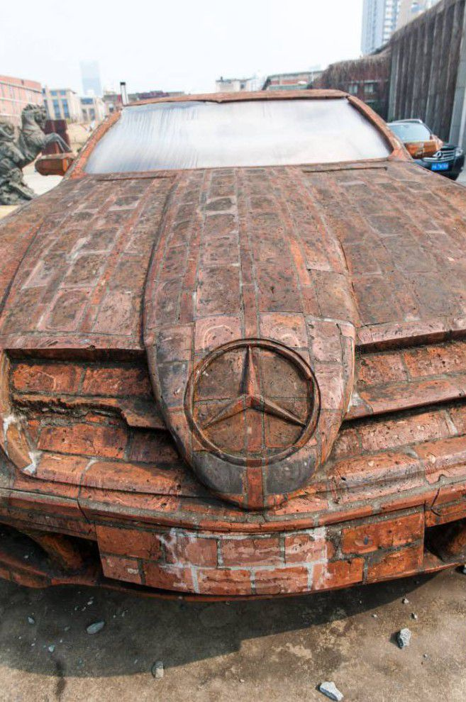 Artist uses red bricks to build peculiar looking Mercedes Benz