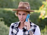 Justin Bieber 'put in chokehold' by security at Coachella after insisting he be let into the VIP section of Drake's show… also 'ordered to leave festival'