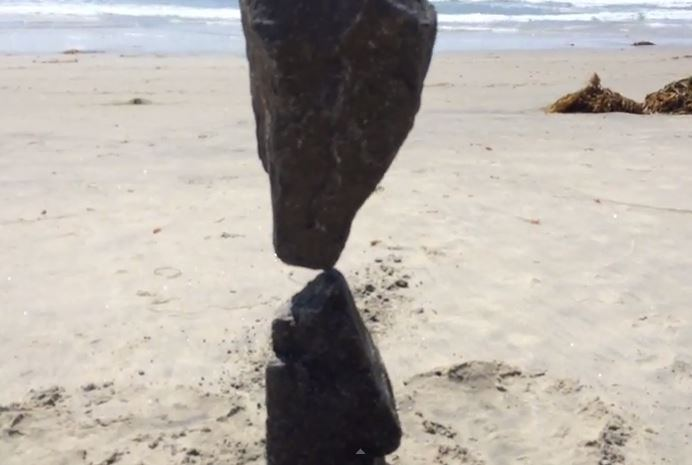 Video shows man balancing rocks in impossible position