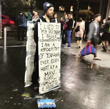 'Lying' boyfriend made to wear humiliating sign in public while people pelt him with eggs