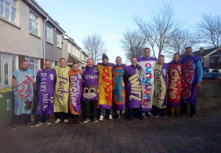 A group of friends have dressed as a Christmas selection box