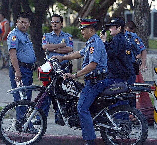 Police officers will be forced to wear NAPPIES during the Pope's visit to the Philippines