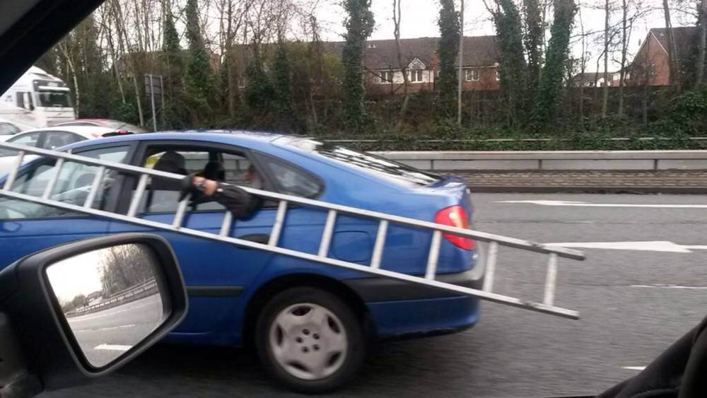 Man clings onto ladder through car window while travelling at 50mph