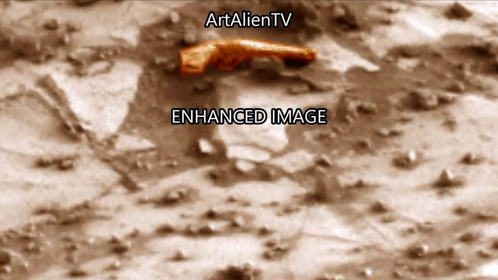Are aliens preparing to go to war? Handgun spotted on Mars by Curiosity