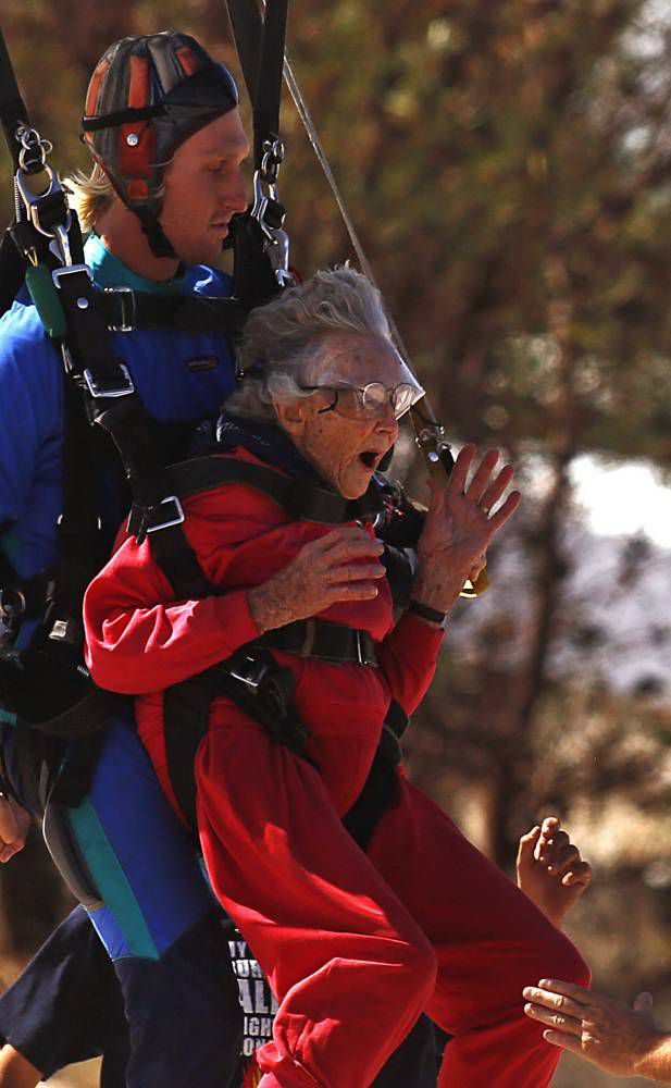 Adrenaline junkie granny takes on sky dive and shark swim for 100th birthday