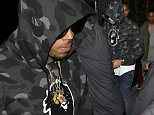 New father Chris Brown goes incognito in sunglasses and a hoodie during night of partying… after ex Karrueche Tran's tearful interview