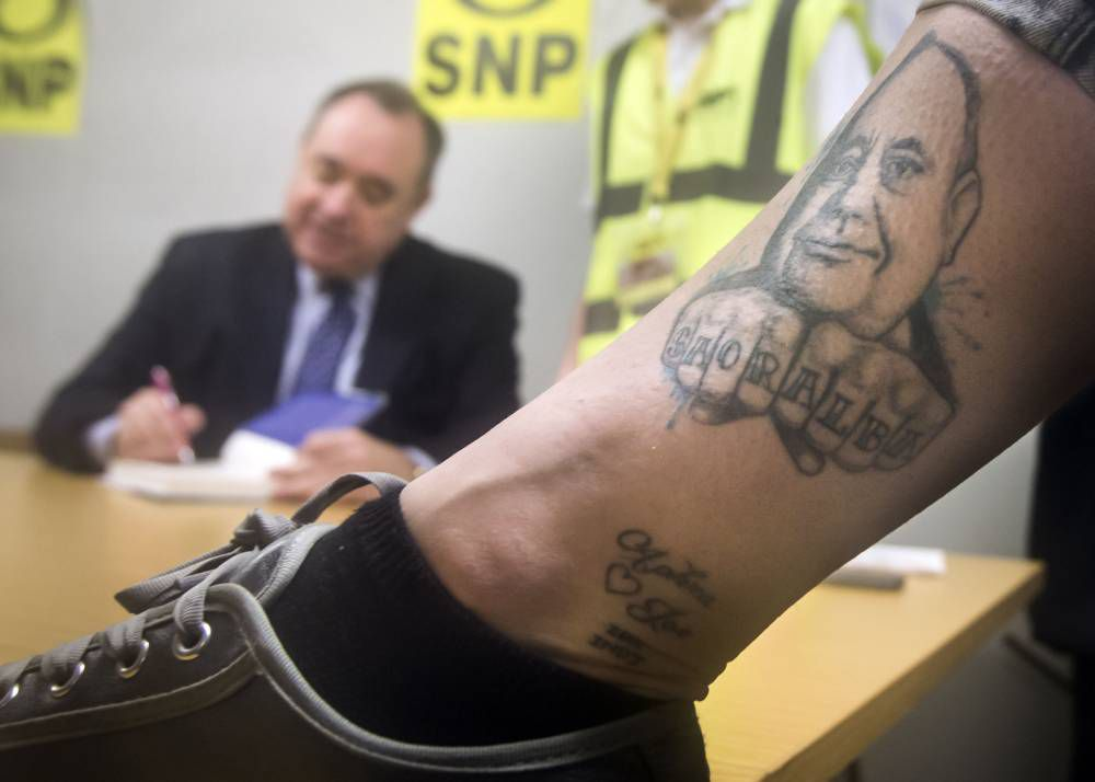 Someone has a tattoo of Alex Salmond on their leg