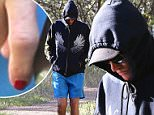 PICTURED: Bruce Jenner wears red nail polish as he emerges after 'boob job' rumours… as he prepares for tell-all interview