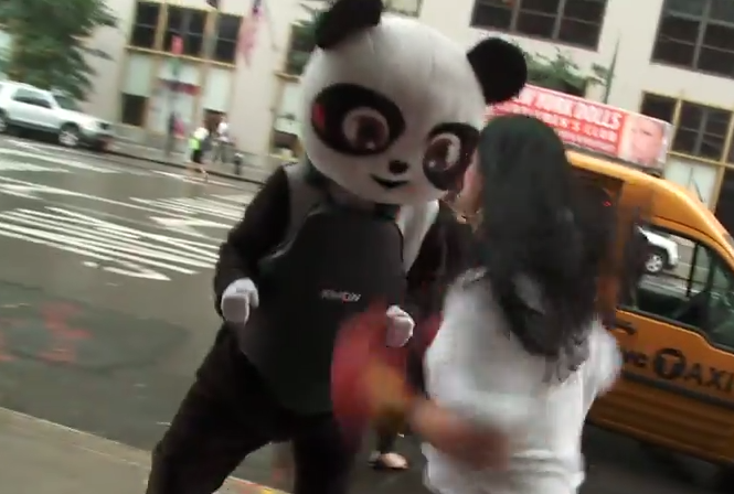 This artist's thing is that he dresses up as a panda and allows people to punch him