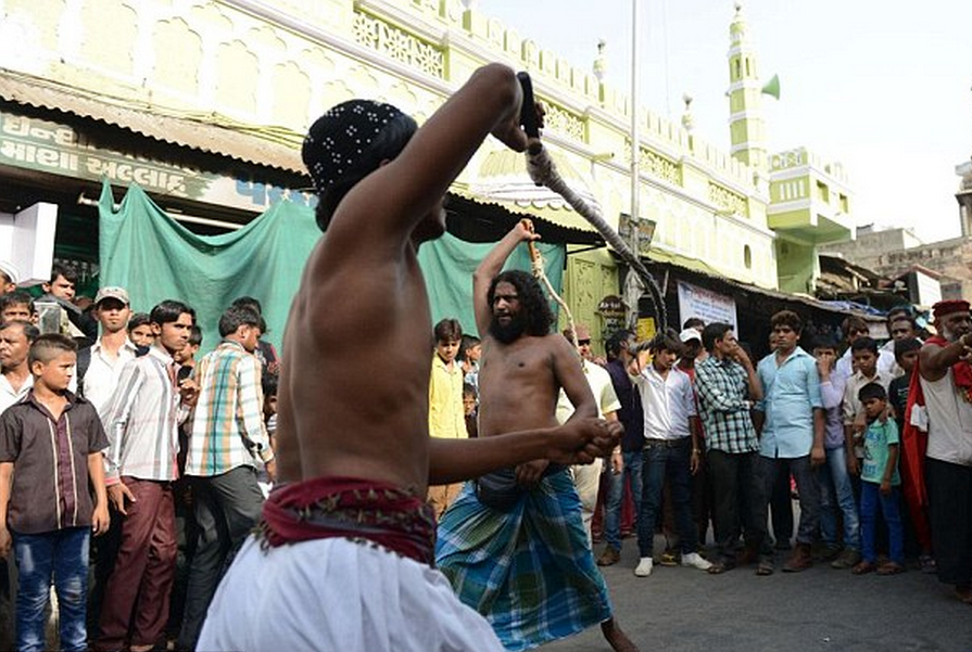 Holy men seen stabbing themselves in the eyes during religious festival in India