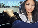 Kylie Jenner uses mobile phone to take a behind-the-wheel photo while driving on the freeway… as dad Bruce is sued for wrongful death of car crash victim