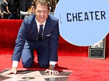 Bobby Flay tries to deflect attention away from bitter divorce by getting his own Hollywood star