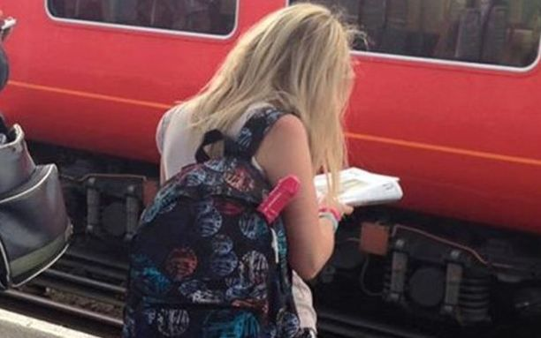 Is that a sex toy sticking out of this woman's bag?