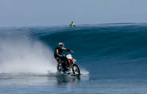 Just a daring stunt rider surfing on a motorbike