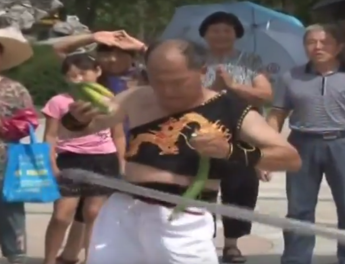 Man uses a hula-hoop to slice up some cucumbers… because he can