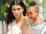 Kim Kardashian admits she's 'bored' as she holds North and Penelope in St. Barts
