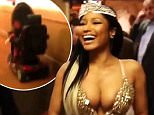 Nicki Minaj commands person in wheelchair to 'walk' while waving her wand in video