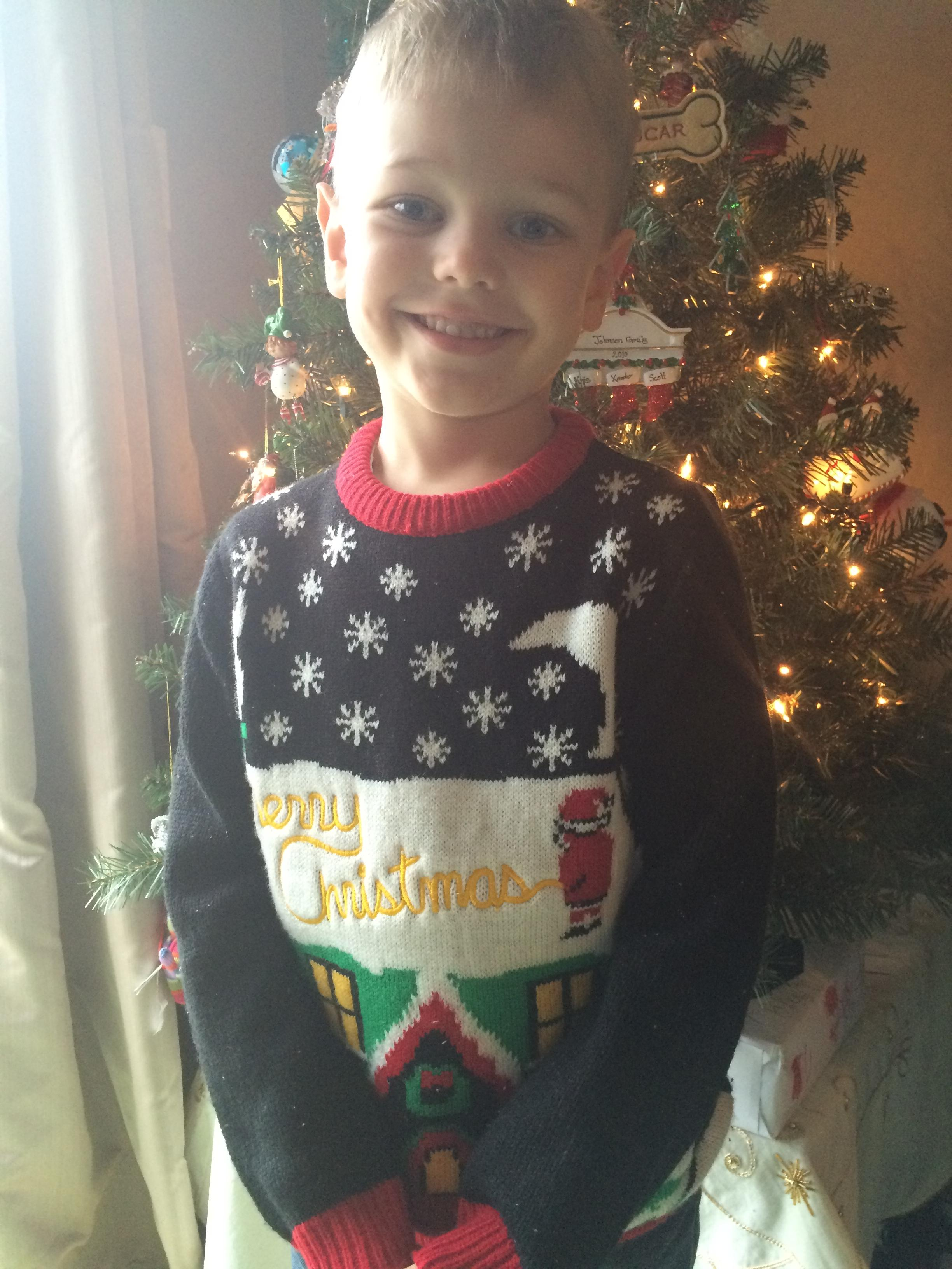 Dad accidentally sends his son to school wearing this naughty Christmas jumper