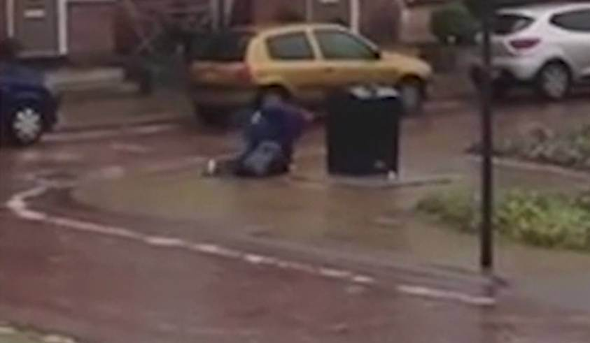 Man crawling on slippery ice just to put rubbish in the bin is all of us