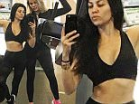 Kourtney Kardashian shows off her RIBS as Khloe covers up for a change