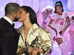 Drake leans in to kiss Rihanna as he presents her with Vanguard Award at MTV VMAs
