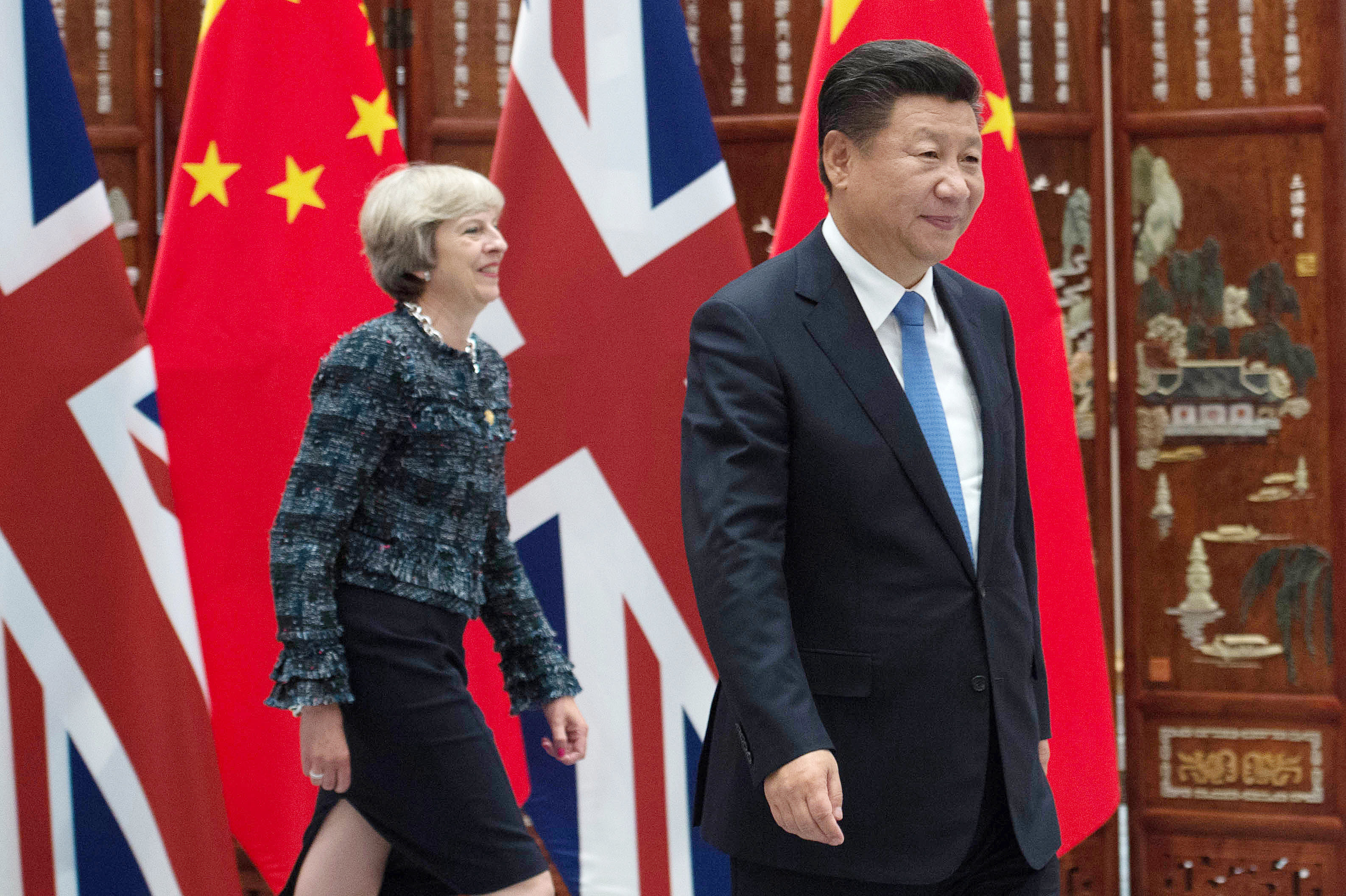 Theresa May Urges China To 'Respect The Rulebook' On Global Trade