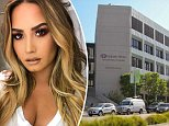 Demi Lovato still in hospital for 'extreme nausea and high fever' following opiate overdose