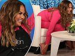 Chrissy Teigen HILARIOUSLY tries to hide her 'Asian jungle feet' under chair on Ellen