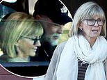 Olivia Newton-John emerges in good spirits after hitting back at claims she's 'clinging to life'