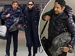 Bradley Cooper weighed down with luggage as he catches flight out of NYC with girlfriend Irina Shayk