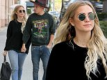 Ashlee Simpson appears smitten as she holds hands with husband Evan Ross for day out in Beverly Hills