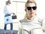 Emma Roberts looks chic in ruffled top as she picks up goodies from Joan's On Third in LA