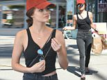 Lucy Hale gives a glimpse of her tummy in cropped vest as she enjoys some retail therapy on a sizzlingly hot day