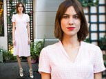 Check her out! Alexa Chung looks effortlessly summery in pale pink gingham at New York fashion launch