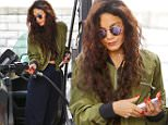 Vanessa Hudgens pumps her own gas in LA while showing off new red claws