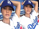 Kourtney Kardashian shows off toned arms while sporting head-to-toe Dodgers gear in throwback photo