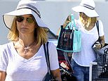Lori Loughlin hides under a summer hat as she picks up six bottles of wine